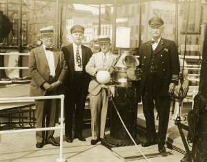 Four men on the deck of a steamship. Man on right is Capt. Moody in 1921