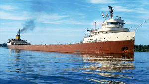 Red freighter with white cabins on very blue water - Edmund Fitzgerald